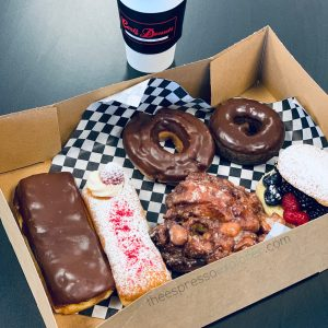 The donuts and coffee at Carl's Donuts are amazing! Here's my stash! Some classic, some fancy!